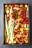 Roast chicken bits with asparagus, cherry tomatoes and potatoes