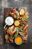 Baked aubergines with chicken and yoghurt sauce