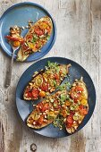 Stuffed aubergines with tomatoes and pine nuts
