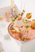 Aperol punch, Lillet tonice and wasabi sticks on a tray