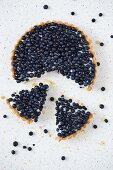 Blueberry tart with two slices cut out