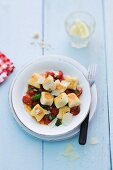 Ricotta dumplings with tomatoes and basil