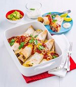 Beef enchiladas with chilli beans and cheese