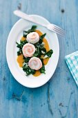 Sole and salmon rolls with spinach and pumpkin sauce