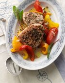 Grilled saddle of pork with a wild herb marinade on a warm pepper salad