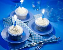 White chocolate cupcakes with candles