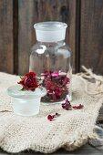 Dried rose petals in a glass jar