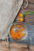 Marigold petals in a glass bowl (seen from above)