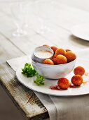 Potato croquettes with paprika and sour cream dip