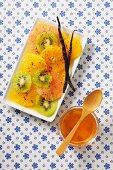 Citrus fruit salad with kiwi, honey and vanilla
