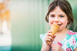 A little girl eating ice cream