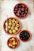 Various olives: dried, Kalamata, stuffed with pepper and stuffed with piri piri