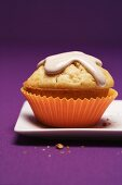 A peach muffin with almonds and cinnamon