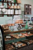 Cakes and pastries in a display cabinet in a vegan bakery