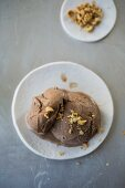 Chocolate ice cream with chopped nuts