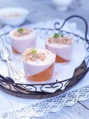Glases of rhubarb mousse with woodruff