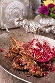 Korma lamb chops with pomegranate seeds