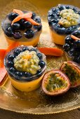 Mini cheesecakes with blueberries and passion fruit