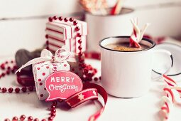 Hot chocolate with candy canes and Christmas decorations