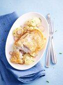 Cod with a potato coating with a potato radish salad