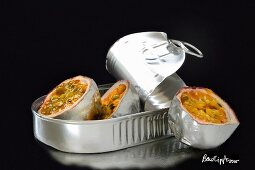Silver passion fruits in a tin