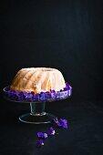 Lemon Bundt cake decorated with violets