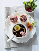 Beef fondue with carrots, radishes and mushrooms (Asia)