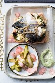 Salmon trout pesto bake with dill mayonnaise and gherkins
