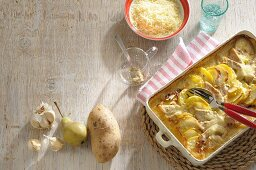 Potato and pear bake with garlic and cheese
