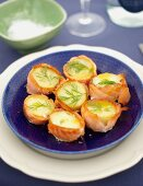 Baked potatoes with dill, wrapped in salmon for a beach picnic