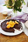 Bittersweet chocolate and apricot jam tart