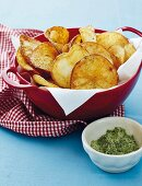 Homemade potato crisps with rosemary salt