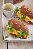 Vegetarian cheese sandwiches with fresh lamb's lettuce