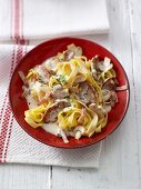 Tagliatelle with pork fillet, mushrooms and bacon