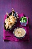 Chicken brochettes with peanut sauce