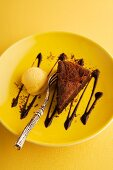 A slice of chocolate mousse cake with pumpkin ice cream