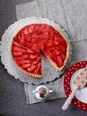 Strawberry tart with white chocolate, sliced