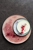 Pelargonian panna cotta with beetroot powder and edible flowers