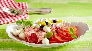 Italian tomato salad with mini mozzarella and salami