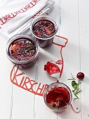 Homemade sour cherry jelly with rosemary