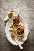 Cheese canapés with a spicy pear compote served with rosemary almonds and bread crisps