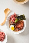 Tonkotsu ramen with pok belly and fresh beetroot noodles