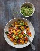 Colourful fried vegetables with an avocado dip and a mango and chilli salsa