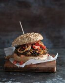 Vegan bean and sweet potato burger with a tomato and lime salsa