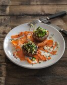 Mushrooms stuffed with buckwheat flakes and courgette on carrot carpaccio (vegan)