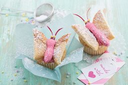 Butterfly cupcakes with raspberry topping