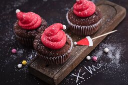 Christmas lingonberry and gingerbread cupcakes decorated with Father Christmas hats