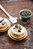 Hearty pumpkin and beer cupcakes with bacon and cream frosting