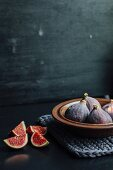 Fresh figs in a ceramic bowl and next to it