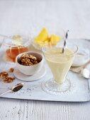 A mango shake with walnuts, chia seeds and honey